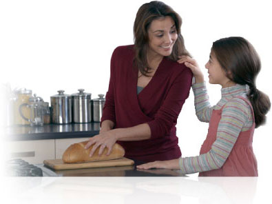 mom and daughter cutting bread